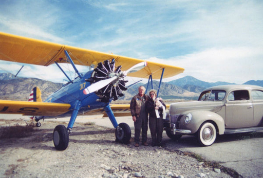 stearman pt-18 and 1940 Ford automobile